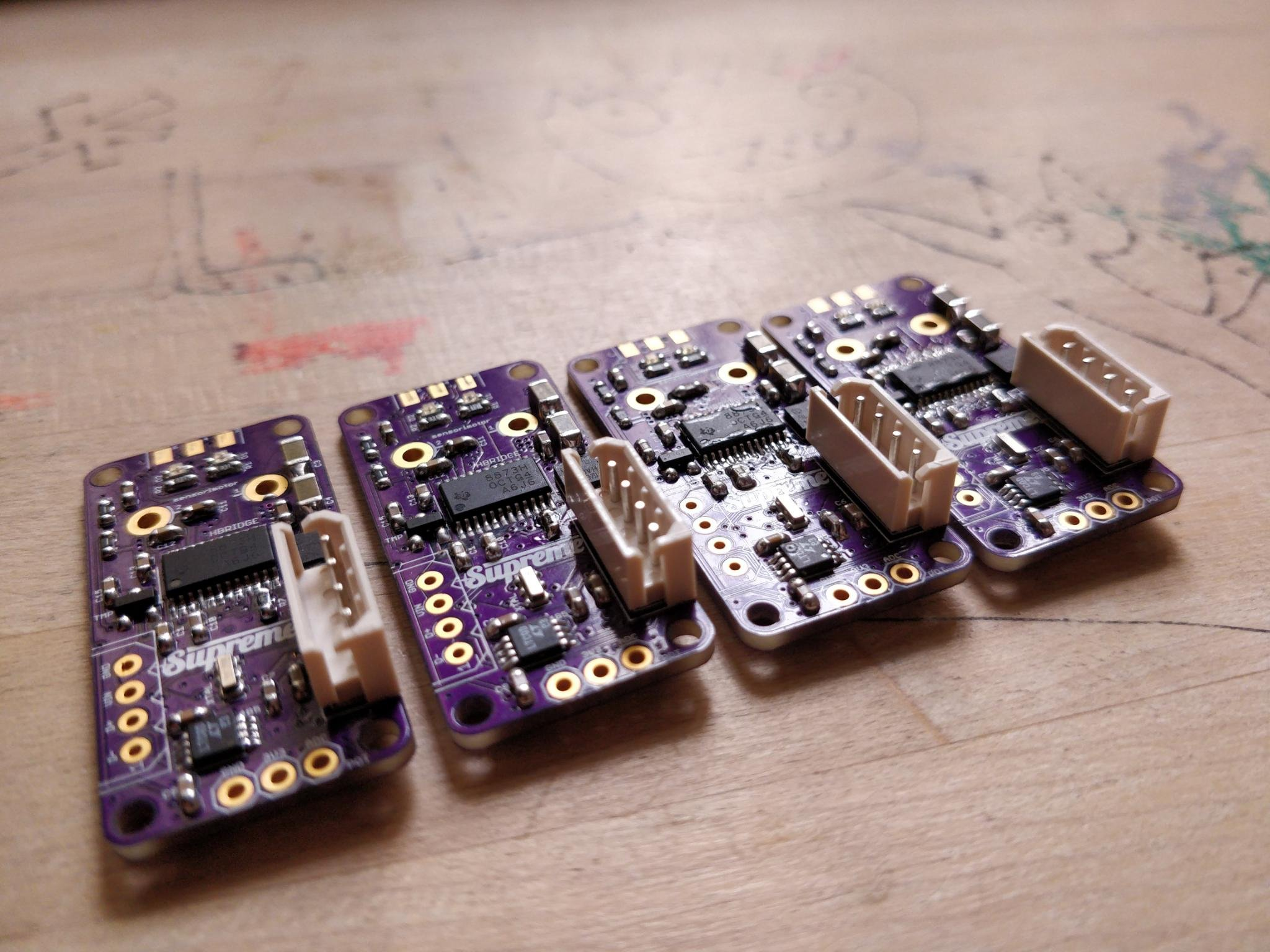 Multiple sensorimotor PCBs lined up for further processing